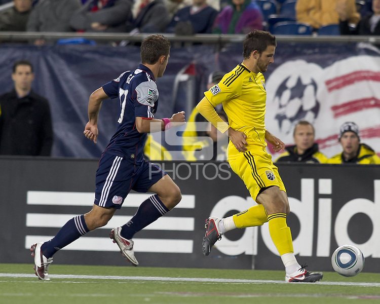 Columbus Crew midfielder Josh Gardner (31) dribbles as New England Revolution midfielder Ryan Guy (13) closes. In a Major League Soccer (MLS) match, the Columbus Crew defeated the New England Revolution, 3-0, at Gillette Stadium on October 15, 2011.