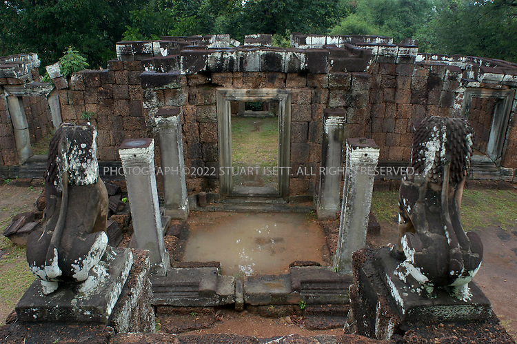 4/20/2003--Angkor Wat Temples, Siem Reap, Cambodia ..BAKONG, Roluos Group...Bakong is located at Roluos south of Prak Ko.It was build in late ninth century (881) by king Indravarman I dedicated to Siva (Hindu) followed Prah Ko art style. ...BACKGROUND .Bakong was the center of the town of Hariharalaya, a name derived from the god Hari-Hara; a synthesis of Siva and Visnu. It is a temple representing the cosmic Mount Meru. Four levels leading to the Central Sanctuary correspond to the worlds of mythical beings (Nagas, Garudas, Raksasas and Yaksas)...All photographs ©2003 Stuart Isett.All rights reserved.This image may not be reproduced without expressed written permission from Stuart Isett.