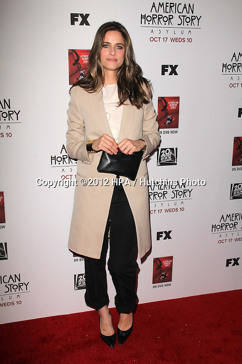 """LOS ANGELES - OCT 13:  Amanda Peet arrives at the """"American Horror Story: Asylum"""" Premiere Screening at Paramount Theater on October 13, 2012 in Los Angeles, CA"""