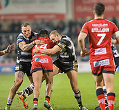 16th March 2018, The AJ Bell Stadium, Salford, England; Betfred Super League rugby, Salford Red Devils versus Hull FC; Lama Tasi is tackled by Dean Hadley and Josh Griffin