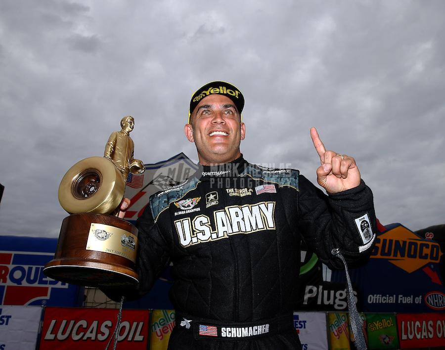 Feb 22, 2015; Chandler, AZ, USA; NHRA top fuel driver Tony Schumacher celebrates after winning the Carquest Nationals at Wild Horse Pass Motorsports Park. Mandatory Credit: Mark J. Rebilas-