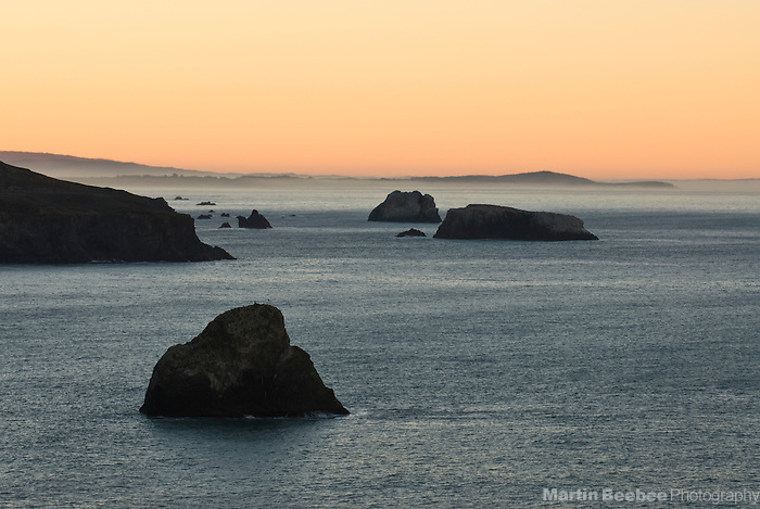 Offshore rocks along the Sonoma County coastline at dawn, California