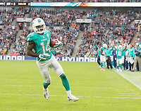 04.10.2015. Wembley Stadium, London, England. NFL International Series. Miami Dolphins versus New York Jets. Miami Dolphins Wide Receiver Jarvis Landry runs in the the End Zone after catching the ball thrown from Miami Dolphins Quarterback Ryan Tannehill.