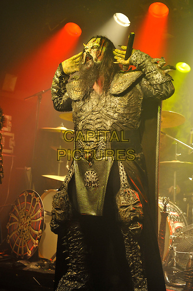 Mr. Lordi (Tomi Putaansuu).Lordi performing in concert, The Garage, London, England. .12th May 2013.on stage live gig performance music masks costume scary monsters half length hands arms 3/4 mouth open   .CAP/MAR.© Martin Harris/Capital Pictures.