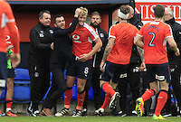 Cameron McGeehan of Luton Town is mobbed by manager Nathan Jones and his team mates during the Sky Bet League 2 match between Luton Town and Mansfield Town at Kenilworth Road, Luton, England on 22 October 2016. Photo by Liam Smith.