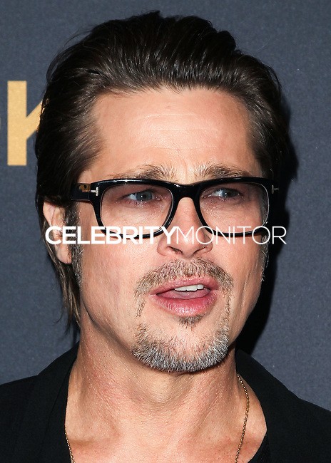 HOLLYWOOD, LOS ANGELES, CA, USA - DECEMBER 15: Brad Pitt arrives at the Los Angeles Premiere Of Universal Pictures' 'Unbroken' held at the Dolby Theatre on December 15, 2014 in Hollywood, Los Angeles, California, United States. (Photo by Celebrity Monitor)