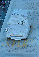 August 12, 2012..A car wrapped in what appeared to be news paper is on display during closing ceremony at the Olympic Stadium on the last day of 2012 Olympic Games in London, United Kingdom.