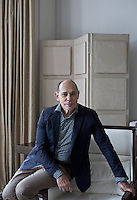 Portrait of Spanish interior designer Thomas Urquijo in the living room of a London town house he designed
