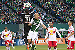 March 3, 2013; Portland, OR, USA; Portland Timbers defender (27) Mikael Silvestre brushes into New York Red Bulls goalkeeper Luis Robles (31) in the first half at Jeld-Wen Field.  Mandatory Credit: Jaime Valdez-USA TODAY Sports