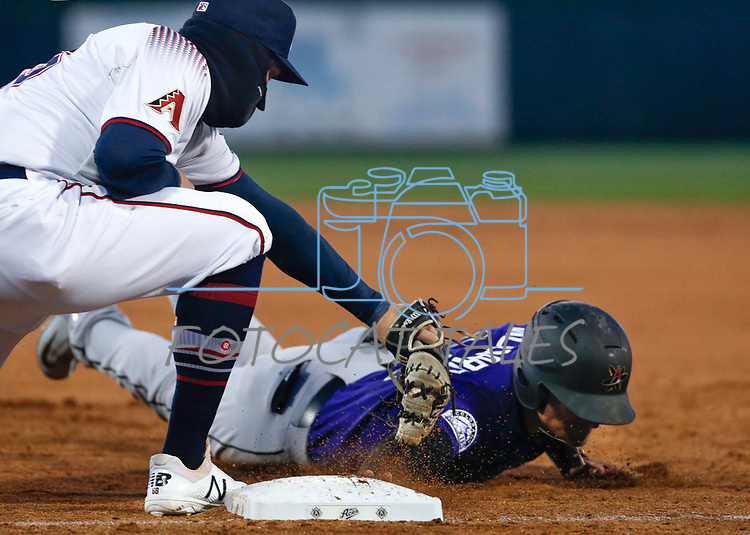 Reno Aces' Kevin Cron tags out Albuquerque Isotopes' Sam Hillard during their home opener in Reno, Nev., on Tuesday, April 9, 2019. The Aces won 4-2. <br />