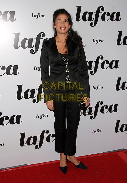 DINA EASTWOOD.attends The 32nd Annual Los Angeles Film Critics Association Awards (LAFCA) held at The InterContinental Los Angeles in Century City, California, USA, .January 14 th 2007..full length black jacket cropped trousers suit red lipstick.CAP/DVS.©Debbie VanStory/Capital Pictures