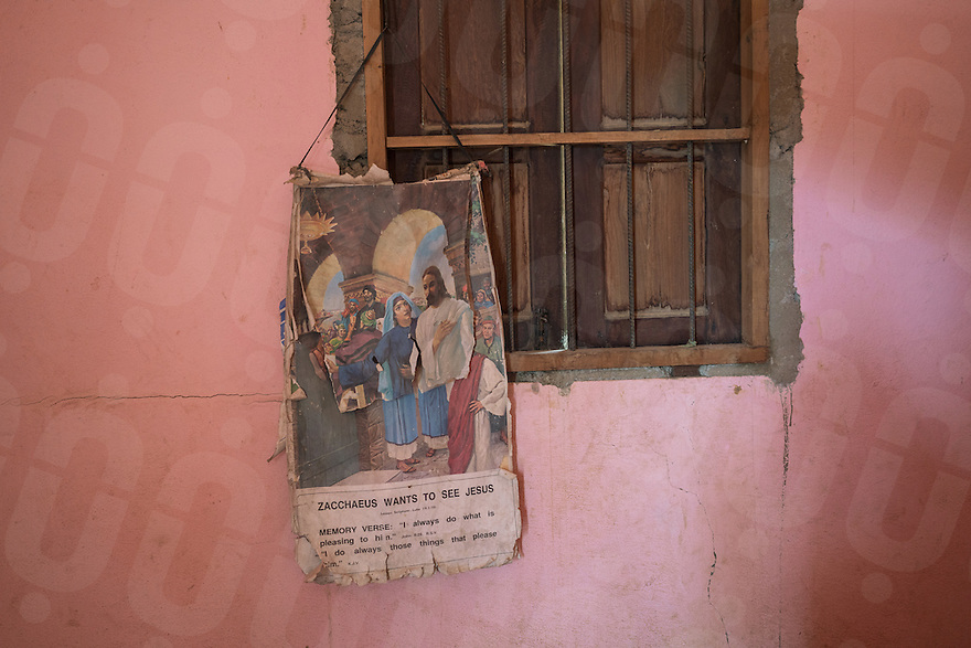 November 27, 2016 - Pailin (Cambodia). An old Christian poster hang on the wall of Sok Sem's house. Sok was a commander of a special military unit of the Khmer Rouge and he converted to christianity in 2011. © Thomas Cristofoletti / Ruom