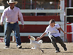 Joseph Brandt, 8, competes in the chicken races during the 51st Annual Virginia City International Camel Races in Virginia City, Nev. on Sept. 10, 2010..Photo by Cathleen Allison