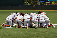 Texas Longhorns team prayer before the NCAA Super Regional baseball game against the Houston Cougars on June 7, 2014 at UFCU Disch–Falk Field in Austin, Texas. The Longhorns are headed to the College World Series after they defeated the Cougars 4-0 in Game 2 of the NCAA Super Regional. (Andrew Woolley/Four Seam Images)