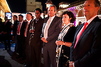 Western Australian Polo Team captain Greg Johnson (3rd from right) stand amongst other guests as they sip pink champagne in front of a jewelry exhibition while listening to a speech before a violin recital at the OzFest Gala Dinner in the Jaipur City Palace, in Rajasthan, India on 10 January 2013. Photo by Suzanne Lee