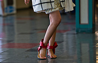 LOUISVILLE, KY - MAY 06: A woman strikes a pose to show off her shoes on Kentucky Derby Day at Churchill Downs on May 6, 2017 in Louisville, Kentucky. (Photo by Douglas DeFelice/Eclipse Sportswire/Getty Images)