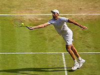 England, London, Juli 06, 2015, Tennis, Wimbledon, Ivo Karlovic (CRO) in action against Murray<br /> Photo: Tennisimages/Henk Koster