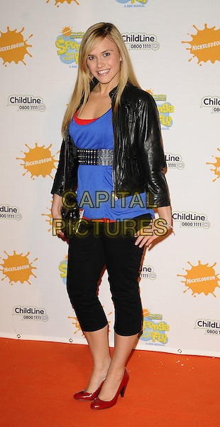 "SARAH SMITH of SAME DIFFERENCE.At the ""Spongebob Squarepants - The Sponge who could Fly"" Gala performance at the Hammersmith Apollo, London, England. .March 5th 2009 .full length black jacket blue top waist belt red shoes studded cropped leggings trousers clutch bag leather sara .CAP/CAN.©Can Nguyen/Capital Pictures."