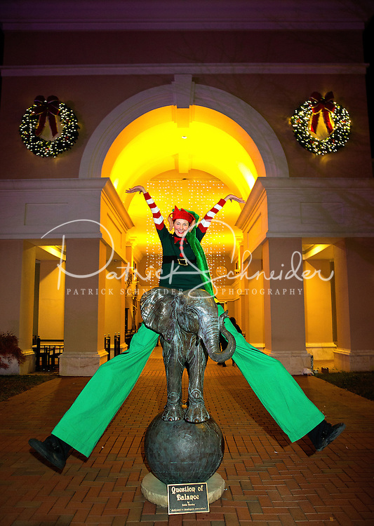 Charlotte Christmas Events - Photography of the Phillips Place Winter Wonderland Christmas event in Charlotte, North Carolina.<br /> <br /> A holiday stilt walker having fun entertaining the children at Charlotte holiday Christmas event.<br /> <br /> Charlotte Photographer - PatrickSchneiderPhoto.com