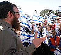 Gary Wilcox/Special...01/18/09... Rabbi Nochum Kurinsky (cq) from the Chabad at the Beaches in Ponte Vedra Beach talks to the crowd during a rally in support of Israel at Jacksonville Beach City Hall Sunday. (01/18/09)..