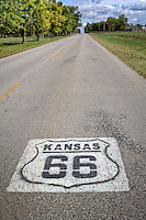 Kansas Route 66 shield painted on the highway west of Riverton Kansas.