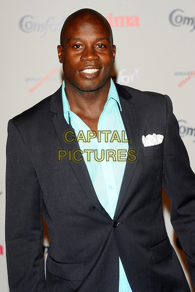 Martin Offiah.Prima High Street Fashion Awards, Battersea Evolutions, Battersea Park, London, England..September 8th, 2011.half length blue suit jacket shirt.CAP/CJ.©Chris Joseph/Capital Pictures.