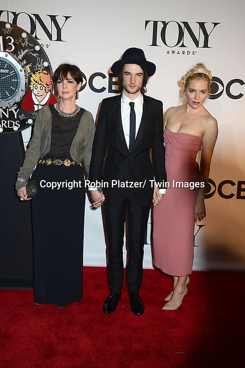 Tom Sturridge and Sienna Miller attend the 67th Annual Tony Awards on Sunday, June 9th at Radio City Music Hall in New York City.