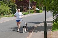 Runner keeping fit by frequent cardiovascular exercise
