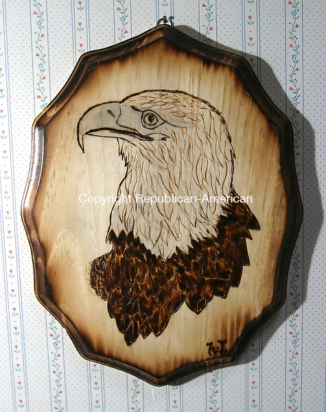 NAUGATUCK, CT 4/2/07- 040207BZ05- Frank Szczesiul, of Naugatuck, burned an image of an eagle into wood..<br /> Jamison C. Bazinet Republican-American