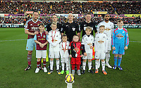 Pictured: Children mascots with team captains Kevin Nolan for West Ham, Ashley Williams for Swansea, refree Michael Dean, s Butt, E Smart Saturday 10 January 2015<br />