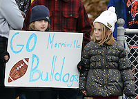 MORRISVILLE, PA - NOVEMBER 27:  Meredith Czyz, 8, of Morrisville, Pennsylvania holds a sign cheering on Morrisville as her sister Olivia Czyz, 5, looks on at Robert Morris Field November 27, 2014 in Morrisville, Pennsylvania.  Bristol defeated Morrisville 53-6. (Photo by William Thomas Cain/Cain Images)
