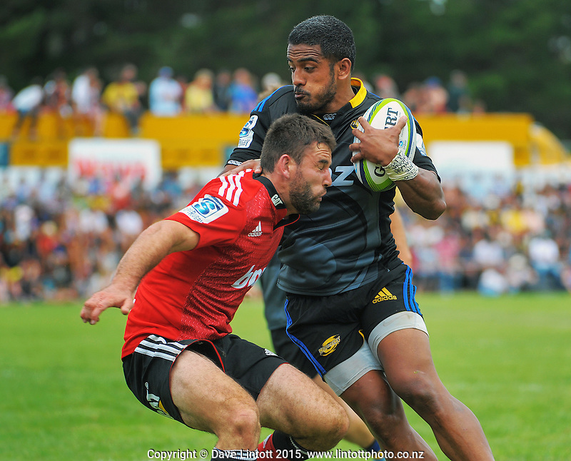 Rey Lee-Lo tries to beat Billy Guyton during the Super Rugby match between the Hurricanes and Crusaders at Eketahuna, New Zealand on Saturday, 31 January 2015. Photo: Dave Lintott / lintottphoto.co.nz