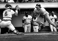 A's catcher Mickey Tettleton waits to tag Boston's .Billy Buckner. (photo by Ron Riesterer)