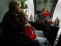 Not much has changed in the past year for Bonnie Bonilla. Her days are still consumed with the care of her four adult children who have Multiple Sclerosis. Bonnie hugs her daugher Norma in their Holly Hill home Tuesday December 17, 2003.(Kelly Jordan)..