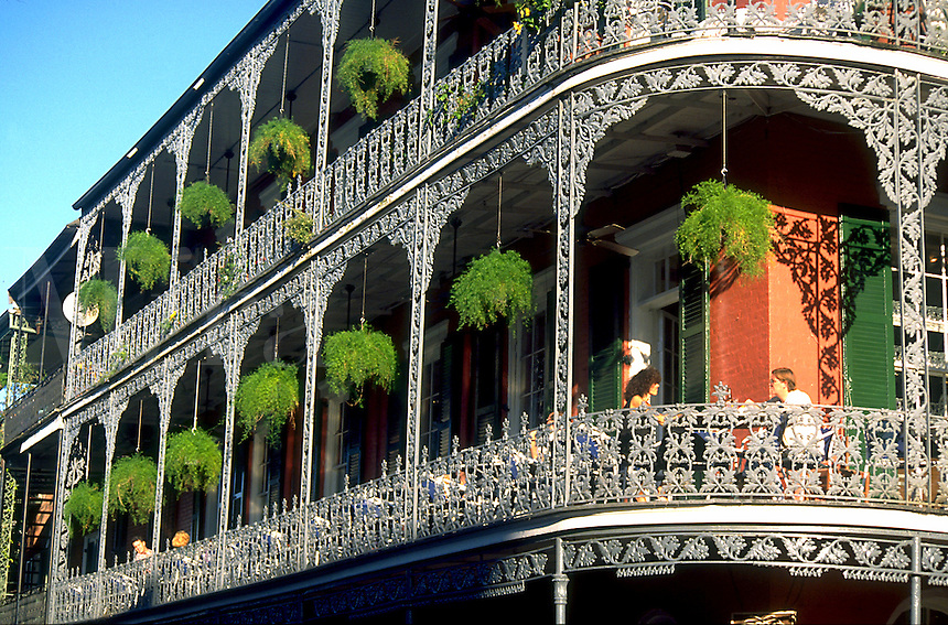 The exterior of the ornate ironwork balcony of the Royal Cafe. French Quarter, New Orleans, Louisiana.