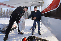 February 16, 2013  Volunteer Jason Spindler helps load volunteer Iditarod Air Force pilot Jerry Moriarity's  plane at the Willow airport as musher food, straw, HEET and people food is flown to the 4 checkpoints on the east side the Alaska Range. ..Iditarod 2013 Photo Copyright Jeff Schultz  -- Do not reproduce without written permission