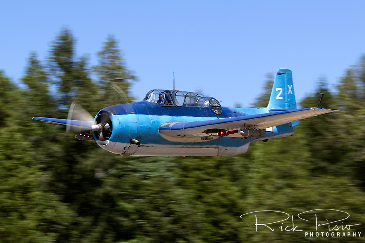 Grumman TBM-3 Avenger, bu85983, piloted by Chuck Wentworth makes a pass down the flight line during the 2013 Grass Valley Airfest held at the Nevada County Airport in California's gold country. This aircraft, like many of the former World War II torpedo bombers saw duty as sprayers and aerial firefighting platforms.