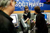 Southwest Airlines employee Joann Pierson (cq) lifts a bag at the ticket counter at Southwest Airlines facilities at Love Field Airport in Dallas, Texas, Wednesday, October 27, 2010...PHOTO/ MATT NAGER