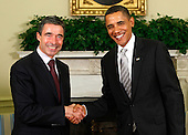 Washington, DC - September 29, 2009 -- United States President Barack Obama (R) shakes hands with NATO Secretary General Anders Fogh Rasmussen (L) in the Oval Office at the White House September 29, 2009 in Washington, DC. Obama and Rasmussen met to discuss new strategy for the war in Afghanistan. .Credit: Alex Wong / Pool via CNP