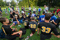 Chase Roberts of the Mt. AIry stars raises his hand to ask about the 1864 rules as Tim Sweeney, Scott Alberts, and Stephen Workman explain the rules. Alberts and Sweeney play for the Athletic Base Ball Club of Philadelphia, while Workman is the club's arbiter or umpire for home games.