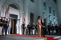US President Barack Obama (R) and First Lady Michelle Obama (L) wait to greet Italian Prime Minister Matteo Renzi and Italian First Lady Agnese Landini prior to the state dinner at the White House in Washington DC, USA, 18 October 2016. President Obama and First Lady Michelle Obama are hosting their final state dinner featuring celebrity chef Mario Batali and singer Gwen Stefani performing after dinner. <br /> Credit: Shawn Thew / Pool via CNP / MediaPunch