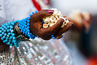 Hands of a Baiana woman seen during the 'popcorn bath', an Afro-Brazilian spiritual cleansing ritual performed in front of the St. Lazarus church in Salvador, Bahia, Brazil, 30 January 2012. Every year on the last Sunday of January, the religious festival of Saint Lazarus takes place on a hill where the chapel of the same name was built in the 18th century. Faithful, of both the Catholic and Candomblé religions, dressed in the traditional white, usually undergo a purification cleansing ritual (banho de pipoca). As both Saint Lazarus and Omolú are related to diseases and healing, followers bring votive objects made of wax as a demonstration of gratitude and faith. The celebration ends with the festive Catholic Mass during which the elements of African mythology are present.