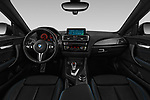 Stock photo of straight dashboard view of a 2017 BMW M2 Base 2 Door Coupe