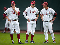 STANFORD, CA - March 25, 2011: Eric Smith, Jake Stewart and Ben Clowe of Stanford baseball talk before Stanford's game against Long Beach State at Sunken Diamond. Stanford lost 6-3.