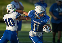 NWA Democrat-Gazette/BEN GOFF @NWABENGOFF<br /> Will Sims (11), Rogers junior, breaks the tackle of Rogers sophomore defender Vincent Vo Friday, Aug. 11, 2017, during Rogers practice at Whitey Smith Stadium in Rogers.