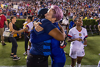 PASADENA, CA - AUGUST 4: Saskia Webber hugs Megan Rapinoe #15 during a game between Ireland and USWNT at Rose Bowl on August 3, 2019 in Pasadena, California.