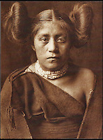 BNPS.co.uk (01202 558833)<br /> Pic: Bloomsbury/BNPS<br /> <br /> A Tewa Girl in 1921.<br /> <br /> Lost souls - Poignant archive reveals the lost tribes of North America in beautiful photographs from just over a century ago.<br /> <br /> A remarkable collection of photographs which give an unprecedented insight into the lives of Native Americans at a time when their land was being taken from them have emerged at auction.<br /> <br /> Between 1907 and 1930, US photographer Edward Curtis spent time with more than 80 native tribes across Native America, taking thousands of photographs as part of his groundbreaking The North American Indian project.<br /> <br /> A collection of more than 500 rare Curtis photographs are being auctioned off later this month and are expected to fetch over &pound;300,000.