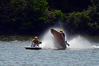 Frame 9: 40-M rides up the rooster tail of 20-M    (Outboard Hydroplane)