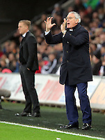 A rather animated Leicester manager Claudio Ranieri asks his players to calm down after their second goal, Swansea manager Garry Monk (L) stand impassive during the Barclays Premier League match between Swansea City and Leicester City at the Liberty Stadium, Swansea on December 05 2015