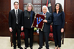 Palestinian President Mahmoud Abbas honours the family of The late Ambassador Azmi al-Daka in the West Bank city of Ramallah on May 31, 2017. Photo by Osama Falah